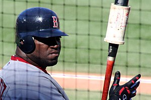 Baseball doughnut - A close-up of a doughnut on a bat held by David Ortiz.