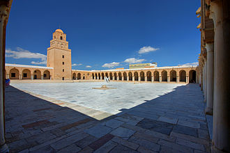 Courtyard - Wide courtyard surrounded by arched porticoes in the Great Mosque of Kairouan in Tunisia