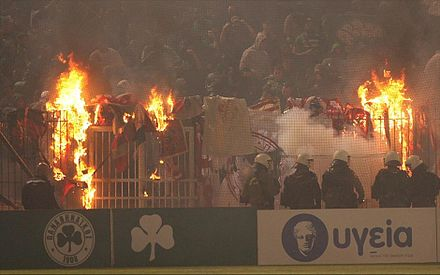 "Panathinaikos fans burn ""spoils"" inside stadium which were gained in battles against hooligans of Olympiakos in the past year. Panathinaikos-olumpiakos-eksedra.jpg"