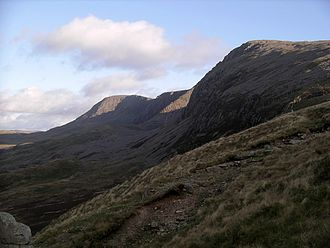 Cadair Idris - Looking at Penygadair (right) from the Pony Path in January 2005. The steep scree route of the Fox's Path is highlighted in sunlight (centre).