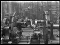 Petone Railway Workshops. Interior view with engineering machinery. ATLIB 290081.png
