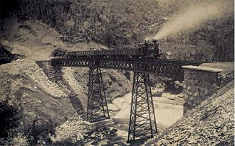 Economy of the Empire of Brazil - Railroad in Petrópolis, 1885. The advent of the trains allowed cargo transportation to become less onerous and much faster, considerably diminishing production costs.
