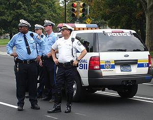 Philadelphia Police Department - Philadelphia police traffic officers with their patrol car