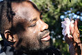Philip Emeagwali examining a flower.jpg