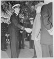 Photograph of President Truman shaking hands with Midshipman William Yates of San Gabriel, California, during his... - NARA - 198671.tif