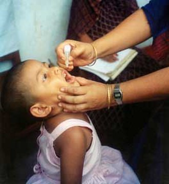 Health system - A child being immunized against polio.