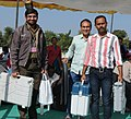 Polling officials carrying the Electronic Voting Machines (EVMs) and other necessary inputs required for the Gujarat Assembly Election, at the distribution centre, in Gandhinagar, Gujarat on December 13, 2017.jpg