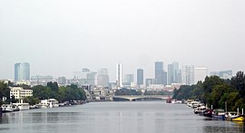 The Seine River with the skyscrapers of La Défense in the background.