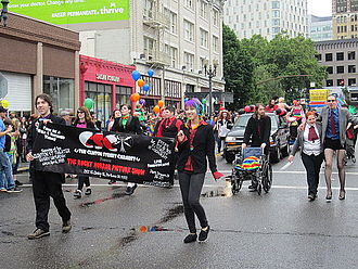 Clinton Street Theater - Members of the Clinton Street Cabaret, who present The Rocky Horror Picture Show, walking in Portland's Pride Parade in 2014