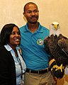Posing for picture with Bald Eagle. (10594851545).jpg
