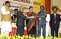Pranab Mukherjee presenting the National Award for Teachers-2014 to Shri Pantakani Mohana Rao, Andhra Pradesh, on the occasion of the 'Teachers Day', in New Delhi. The Union Minister for Human Resource Development.jpg