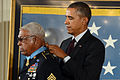 President Barack Obama, right, awards a Medal of Honor to retired U.S. Army Sgt. 1st Class Melvin Morris during a ceremony at the White House in Washington, D.C., March 18, 2014 140318-D-DB155-003.jpg