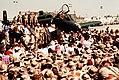 President George H. W. Bush speaks to a crowd at an air base in Saudi Arabia.jpg
