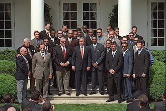 Mariano Rivera - Rivera (front, second from right) and fellow teammates from the 2000 World Series champion Yankees team pose with US President George W. Bush during a White House visit