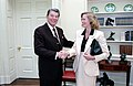 President Ronald Reagan greeting actress Cybill Shepherd in the Oval Office.jpg