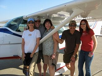 Private aviation - Pilot and family, with their Cessna 172