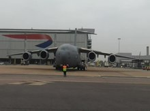File:RAF C-17 being marshalled at Heathrow.ogv