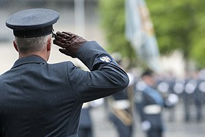 Warrant officer (United Kingdom) - An RAF warrant officer saluting the colours.
