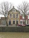foto van Herenhuis met hoog schilddak en aan de achterzijde puntgevel