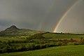 Rainbow over Bořeň Hill - panoramio.jpg