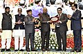 """Ram Nath Kovind presenting the """"Vayoshreshtha Sammans - 2017"""" to eminent senior citizens and institutions in recognition of their service towards the cause of the elderly persons, at a function, in New Delhi (3).jpg"""