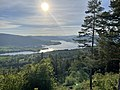 Randsfjorden (nordre ende, northern part of lake), Fluberg kirke, Odnes, Dokkadeltaet, Rostberget, etc. Søndre Land municipality, Norway. Evening sun backlight, forests, hills. View from Granum Gård boarding house 2021-06-01 IMG 1.jpg