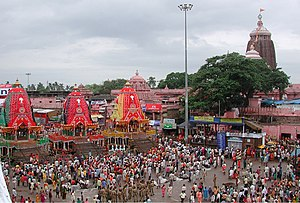 Jagannath Temple, Puri - The Rath Yatra in Puri in modern times showing the three chariots of the deities with the Temple in the background
