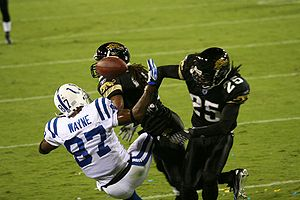 Health issues in American football - Speed players, such as the wide receiver and defensive backs in this picture, can be prone to high momentum collisions, which can put them at greater risk for neurodegenerative disorders in later life.