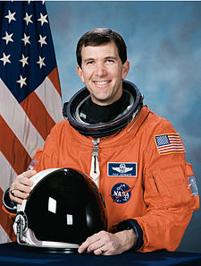 Richard Husband, NASA photo portrait in orange suit.jpg