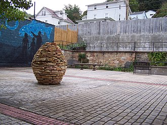 Richwood, West Virginia - The Sterling Spencer Memorial Sculpture Garden replaced a dilapidated vacant hotel that had partially collapsed. The park is named in honor of a respected wood sculptor from Richwood.