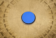Close interior photo of the Pantheon's circular oculus opening at the center of the domed ceiling