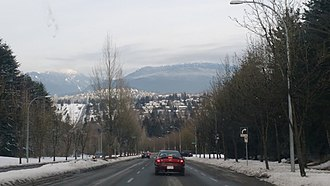 Burnaby - Capitol Hill and North Shore mountains as seen from Deer Lake Park.