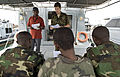 Royal Netherlands Army Sgt. 1st Class Reinier Hakvoorb, top right, explains medical evacuation procedures to Djiboutian, Sudanese and Rwandan service members during exercise Cutlass Express 2013 at the Port 131113-F-NJ596-062.jpg