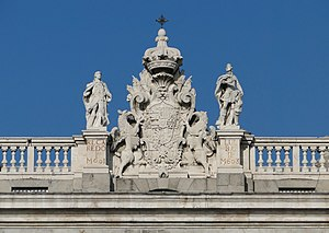 Royal Palace of Madrid - Detail of the facade over the Prince's Gate. Reccared II and Liuva II, Visigoth kings, flanking the arms of Spain. The statues do not match the names on the bases.