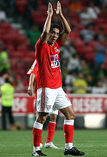 Rui Costa, clapping his hands over his head after scoring a goal