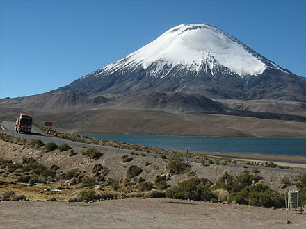 The lava domes are visible as grey hills Ruta 11 - Lago Chungara - Volcan Parinacota.jpg