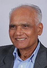 A photograph of a smiling old man.