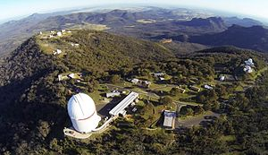 Siding Spring Observatory - Siding Spring Mountain with Anglo-Australian Telescope dome visible near centre of image.