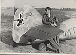 SSgt. Erik Lyly with his Bf-109G6 on summer 1943.jpg
