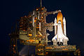 STS-135 lit up on launch pad 39a.jpg