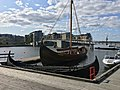 Saga Farmann Klåstadskipet viking ship replica built 2018 row boat Tønsberg harbour pier board walk dock brygge havn Oseberg kulturhus Quality hotel Kaldnes bro footbridge Byfjorden etc Norway 2019-08-21 0054.jpg