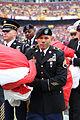 Salute To Service flag unfurling 141116-Z-JK922-325.jpg
