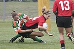 "Savannah's Katie Thomen tackling Lauren ""Speedy"" Buslinger Raleigh Venom vs. Savannah.jpg"