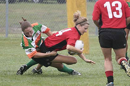 "A women's rugby sevens game in the USA Savannah's Katie Thomen tackling Lauren ""Speedy"" Buslinger Raleigh Venom vs. Savannah.jpg"