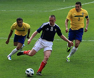 Scott Brown (footballer, born June 1985) - Brown (number 8) playing for Scotland against Brazil in March 2011