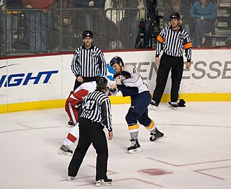 Shea Weber - Weber (right) in a fight with Andreas Lilja (left) of the Detroit Red Wings during the 2008–09 season.