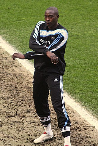 Shola Ameobi - Ameobi warming up on the sidelines against Ipswich Town in 2010.