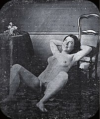 Smiling nude woman by anonymous photographer c.1855.jpg