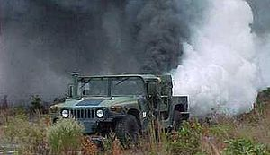 Smoke screen - A U.S. Army Humvee laying a smoke screen
