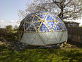 Solar dome full immpression-with pentagon window wood base door.jpg